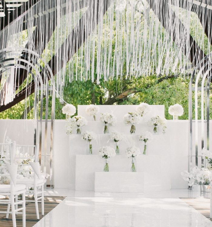 white wedding decorated with flowers