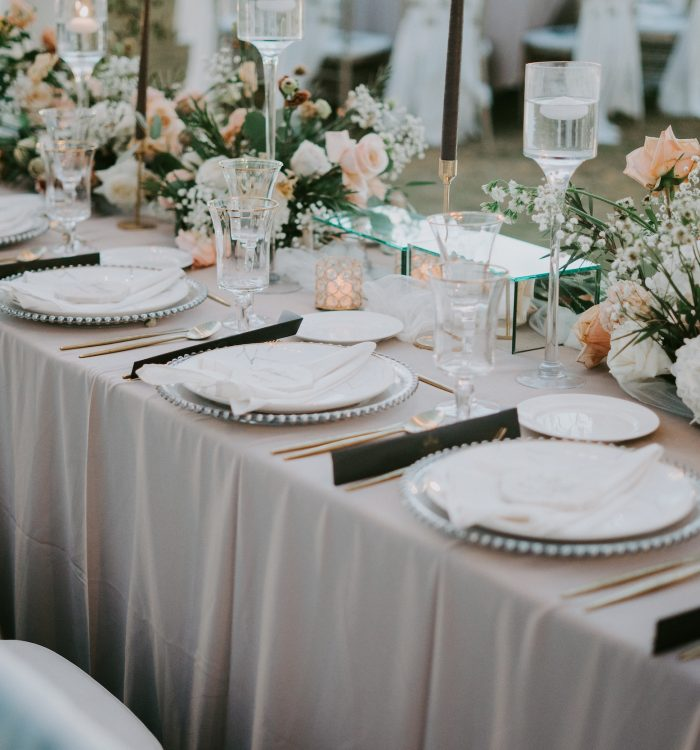 Decorated table setting with a floral design for a wedding celebration during daytime
